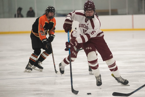 Gloucester's Jeremy Abreu brings the puck up ice. Gloucester hosted Beverly at the Talbot Rink, routing the Panthers 7-1. RYAN MCBRIDE/Staff photo 2/15/20