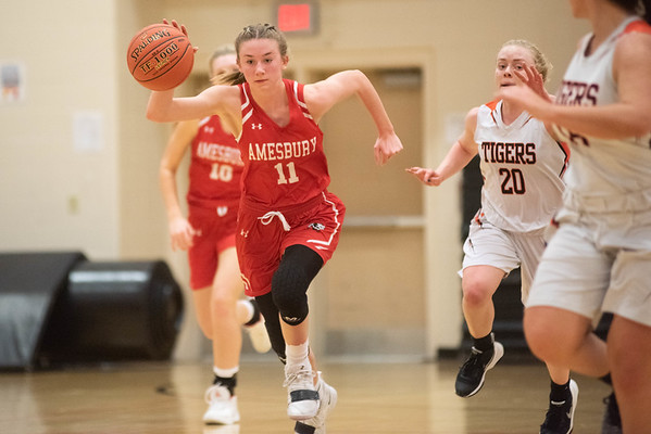 Amesbury's Avery Hallinan pushes up court on a fast break. Ipswich hosted the Amesbury Indians Thursday evening. RYAN MCBRIDE/Staff photo 2/13/20