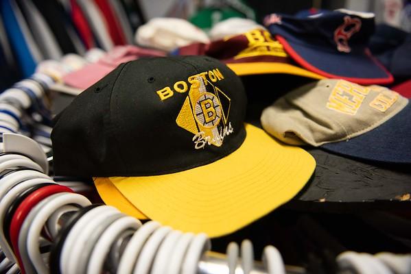 A Boston Bruins hat lays on a rack inside of The Felt Fanatic in Salem. RYAN MCBRIDE/Staff photo 2/20/20