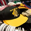 A Boston Bruins hat lays on a rack inside of The Felt Fanatic in Salem. RYAN MCBRIDE/Staff photo 2/20/20