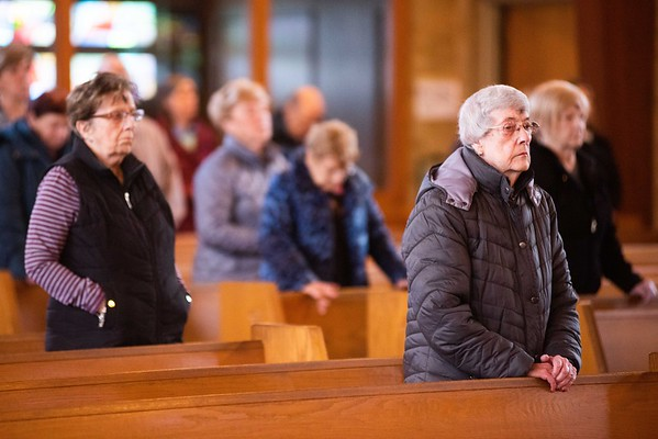 Parishioners attend mass and receive their ashes on Ash Wednesday at St. Richard Parish in Danvers. RYAN MCBRIDE/Staff photo 2/26/20