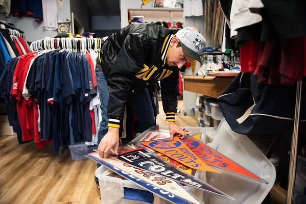 Zach Goodman looks at Houston Colts pennants. RYAN MCBRIDE/Staff photo 2/20/20