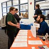 Julie Lawless, 43 years old, a senior, talks with Paul Riley, a regional recruitment manager for City Year. Salem State held it's Career Closet day at Ellison Campus Center on Thursday. RYAN MCBRIDE/Staff photo 2/20/20