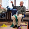 John Vasiloui, center, of Marblehead, enjoys the stretching exercises. Strength in Motion, the Parkinson's Fitness class runs every Tuesday from 11:00 AM to Noon at the Marblehead Council on Aging. RYAN MCBRIDE/Staff photo 2/25/20