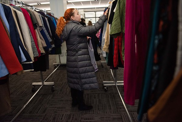 Angelica Perez, 20 years old, a senior, looks for articles of clothing. Salem State held it's Career Closet day at Ellison Campus Center on Thursday. RYAN MCBRIDE/Staff photo 2/20/20