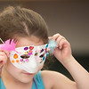 Eloise Alder, 5, tries on her finished Mardi Gras mask. Hamilton Wenham Library hosted a Mardi Gras mask making day on Saturday. RYAN MCBRIDE/Staff photo 2/22/20