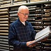 Dan Driscoll looks at the books inside of the City Clerk's vault, where birth, death and marriage records are kept. Driscoll is a volunteer at the Beverly City Clerk's office. Gov. Charlie Baker is proposing to limit access to vital records. RYAN MCBRIDE/Staff photo 2/18/20