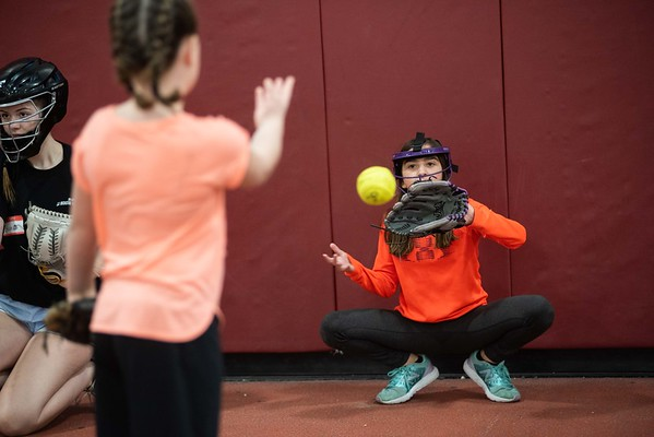 Adrianna Orlando, 10 years old, of Gloucester catches the ball while practicing being behind the plate as a catcher. The GHS youth softball clinic took place at Gloucester High School Thursday morning. RYAN MCBRIDE/Staff photo 2/20/20