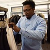 AJ Nwokeji, 24 years old, a senior of Salem State, looks for articles of clothing. Salem State held it's Career Closet day at Ellison Campus Center on Thursday. RYAN MCBRIDE/Staff photo 2/20/20
