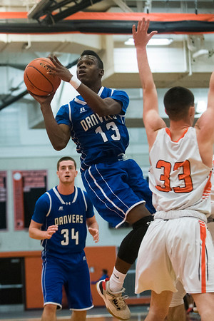 Danvers junior Tahg Coakley goes up for a basket in their game against Beverly at Beverly High School. 1/3/17