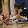 Essex Tech's Lauren Mitchell fights Presentation of Mary Academy's Elaina Catino for the ball in their game at Essex Tech. Essex Tech won the game 52-25. 1/17/17