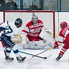 SAM GORESH/Staff photo. Masconomet goalie freshman Tucker Hanson blocks an attempted goal by Peabody junior Ethan Leblanc with his stick in the inaugural 'Can Do' Classic. The game ended in a 3-3 tie. 1/2/17