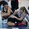 Salem freshman Angelica Rego fights Peabody senior Kelly Crotty for a loose ball in their game at Peabody High School. 1/10/17