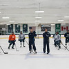 SAM GORESH/Staff photo.  Pingree hockey coach Chris Connolly (left, center) and assistant coach Jerry Toomey (right, center) pose for a portrait with the  Pingree hockey team. The team won three games in a row for the first time in six years. 1/17/17