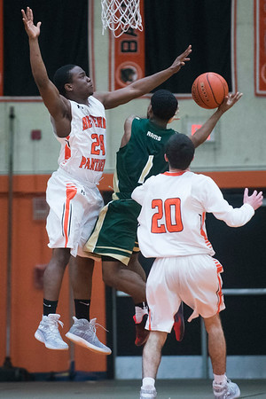 Beverly senior Hugh Calice jumps in attempt to block a basket by Lynn Classical senior Gilbert Minaya in their game at Beverly High School. Lynn Classical won the game 68-65. 1/27/17