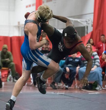 SAM GORESH/Staff photo. Salem's Tyrese Elmidor wrestles Danvers's Russ Canova in the 160 pound bout in their meet at Salem High School. 1/10/17
