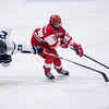 SAM GORESH/Staff photo. Masconomet freshman Zachary Smith attempts to maintain control of the puck as Peabody junior Ethan Leblanc reaches to try to stop him on defense in the inaugural 'Can Do' Classic. The game ended in a 3-3 tie. 1/2/17