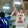 Beverly freshman Duncan Moreland goes up for a basket as Danvers sophomore Kyle White attempts to stop him on defense in their game at Beverly High School. 1/3/17