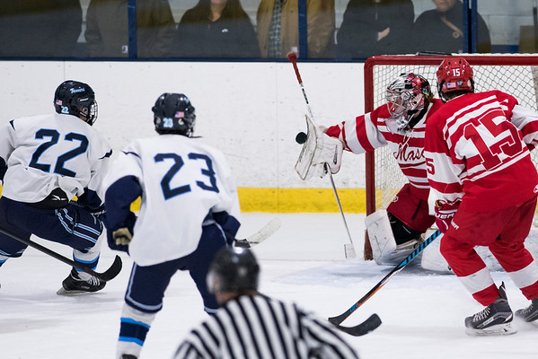 SAM GORESH/Staff photo. Masconomet goalie freshman Tucker Hanson blocks an attempted goal in the inaugural 'Can Do' Classic against Peabody. The game ended in a 3-3 tie. 1/2/17