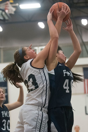 Essex Tech's Grace Wetherbee fights Presentation of Mary Academy's Liliana Foucault for the ball in their game at Essex Tech. Essex Tech won the game 52-25. 1/17/17