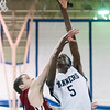 SAM GORESH/Staff photo. Peabody sophomore Chibuikem Onwuogo as Gloucester player Kenny Turner attempts to block him on defense in their game at Peabody High School. Peabody won the game 67-42. 1/20/17