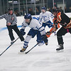 SAM GORESH/Staff photo. Danvers junior Thomas Mento takes control of the puck as Beverly senior Terran Mazzagliz attempts to stop him on defense in their game at Bourque Arena. 1/6/17