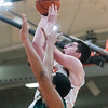 Beverly senior Patrick Gavin attempts a basket as Lynn Classical junior Eric Solis attempts to stop him on defense in their game at Beverly High School. Lynn Classical won the game 68-65. 1/27/17