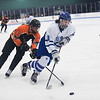 SAM GORESH/Staff photo. Danvers sophomore Conor Hanlon takes control of the puck as Beverly senior Kristopher Mullaney attempts to stop him on defense in their game at Bourque Arena. 1/6/17