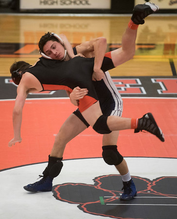 Beverly's Brett Wolonsovich gets thrown by Marblehead-Swampscott's Stephen Hopkins in the 138 pound bout in their meet at Beverly High School. 1/18/17