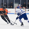 SAM GORESH/Staff photo. Beverly senior Kristopher Mullaney tries to keep the puck away from  Danvers freshman Patrick Gilligan in their game at Bourque Arena. 1/6/17