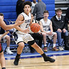 HADLEY GREEN/Staff photo<br /> Peabody's Chris Canela (23) dribbles at the Peabody v. Salem boys basketball game at Peabody High School.<br /> <br /> 01/30/18