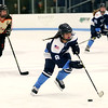 HADLEY GREEN/Staff photo<br /> Peabody's Sammie Mirasolo (8) skates to the net and scores at the Beverly v. Peabody girls hockey game at Endicott College.<br /> <br /> 1/06/17