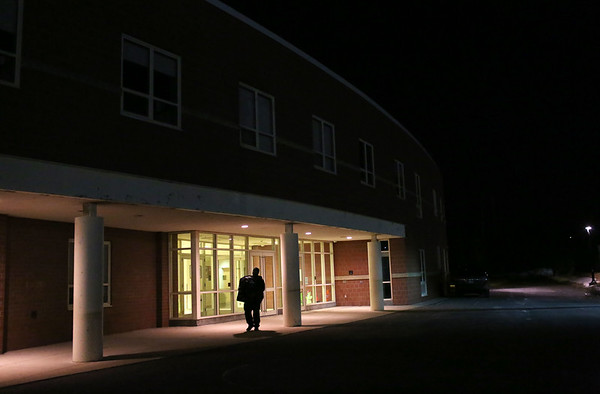 HADLEY GREEN/Staff photo<br /> A man walks out of the Nathaniel Bowditch School after a public meeting confirms the school's upcoming closure. <br /> <br /> 01/24/18