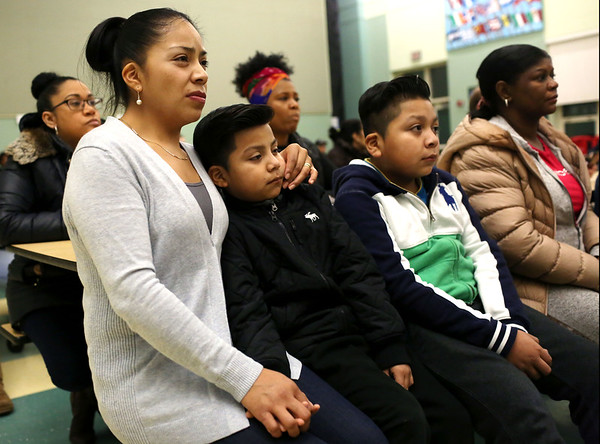 HADLEY GREEN/Staff photo<br /> Leticia Tomas sits with her sons Caleb, left, and Erik, right, during the meeting about the Nathaniel Bowditch School's closure. Caleb is a second grader at the school.  <br /> <br /> 01/24/18