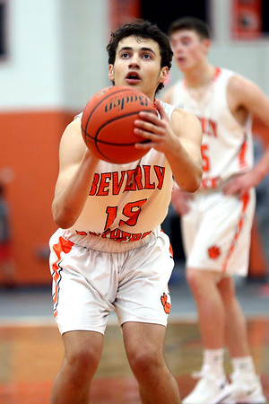 HADLEY GREEN/Staff photo<br /> Bevelry's Toskany Abreu (15) shoots a free throw at the Beverly v. Lynn Classical boys basketball game at Beverly High School.<br /> <br /> 1/09/17
