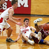 HADLEY GREEN/Staff photo<br /> Masconomet's Matt Dzwil (5) and Newburyport's George Coryell (0) fight for the ball at the Masconomet v. Newburyport boys basketball game.<br /> <br /> 1/12/17