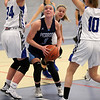 HADLEY GREEN/Staff photo<br /> Peabody's Catherine Manning (3) looks to the basket while Danvers defenders surround her at the Danvers v. Peabody girls basketball game at Danvers High School. <br /> <br /> 01/03/17