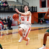 HADLEY GREEN/Staff photo<br /> Beverly's Matt Rawding (23) dribbles through Lynn Classical defenders and shoots at the Beverly v. Lynn Classical boys basketball game at Beverly High School.<br /> <br /> 1/09/17