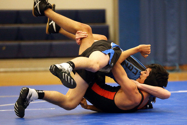 HADLEY GREEN/Staff photo<br /> Beverly's Bryan Agudelo wrestles Danvers' Matt Gagny at the Danvers v. Beverly wrestling match at Danvers High School.<br /> <br /> 01/03/17