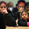 HADLEY GREEN/Staff photo<br /> Elsie Santos and her daughter Jelsieani Febres listen to Salem School Superintendent Margarita Ruiz speak about the school's closure. Ruiz announced to students, families and community members that the school will be dissolved after this year and students will be absorbed into other Salem public schools. <br /> <br /> 01/24/18