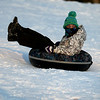 HADLEY GREEN/Staff photo<br /> Joselyn Silva bundles up to sled down the hill at Lynch Park in Beverly on Saturday.<br /> <br /> 1/06/17
