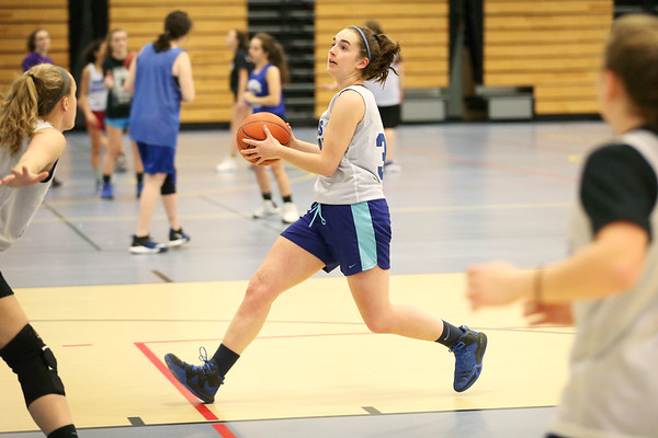 HADLEY GREEN/Staff photo<br /> Lilly Montanari runs towards the basket at the Danvers girls basketball practice at Danvers High School.<br /> <br /> 02/01/18