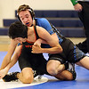 HADLEY GREEN/Staff photo<br /> Beverly's Bryan Agudelo wrestles Danvers' Matt Gagny at the Danvers v. Beverly wrestling match at Danvers High School.<br /> <br /> 01/03/17