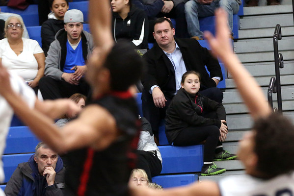 HADLEY GREEN/Staff photo<br /> Peabody Mayor Bettencourt watches the Peabody v. Salem boys basketball game at Peabody High School.<br /> <br /> 01/30/18
