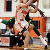 HADLEY GREEN/Staff photo<br /> Beverly's Toskany Abreu (15) aims for the basket while Lynn Classical's Dyrrell Rucker (23) plays defense at the Beverly v. Lynn Classical boys basketball game at Beverly High School.<br /> <br /> 1/09/17