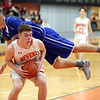 HADLEY GREEN/Staff photo<br /> Beverly's Duncan Moreland (35) prepares to shoot while Danvers' Kyle White (4) jumps over him at the Beverly v. Danvers boys basketball game at Beverly High School.<br /> <br /> 01/05/17