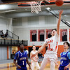 HADLEY GREEN/Staff photo<br /> Beverly's Kyle Camara (3) dribbles past Danvers' defenders and shoots at the Beverly v. Danvers boys basketball game at Beverly High School.<br /> <br /> 01/05/17