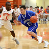 HADLEY GREEN/Staff photo<br /> Danvers' Justin Roberto (21) moves towards the net at the Beverly v. Danvers boys basketball game at Beverly High School.<br /> <br /> 01/05/17