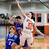 HADLEY GREEN/Staff photo<br /> Beverly's Matt Rawding (23) shoots while Beverly's Jonathan Weimert (20) plays defense at the Beverly v. Danvers boys basketball game at Beverly High School.<br /> <br /> 01/05/17