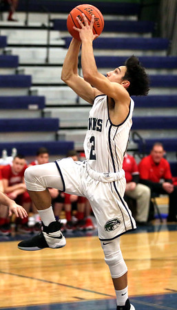 HADLEY GREEN/Staff photo<br /> Essex Tech's Kendall Hersey (12) shoots at the Essex Tech v. Saugus boys basketball game at Essex Tech. <br /> <br /> 01/16/18